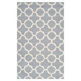 Wool rug with a Moroccan tile motif. Hand-tufted in India.   Product: RugConstruction Material: WoolColor: Silver and ivoryFeatures:  Made in IndiaHand-tufted Note: Please be aware that actual colors may vary from those shown on your screen. Accent rugs may also not show the entire pattern that the corresponding area rugs have.Cleaning and Care: Professional cleaning recommended