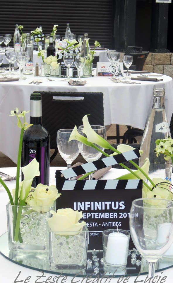Soirée La Siesta  Centre de table thème cinéma avec fleurs blanches,  bougie et petit
