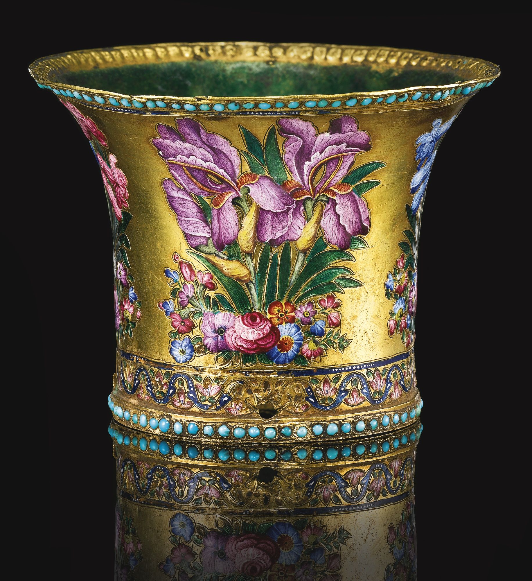 A FINE QAJAR GOLD AND POLYCHROME ENAMELLED GHALIAN CUP, PERSIA, 19TH CENTURY of waisted form with iris blossoms on floral tufts on a gold ground, between two bands of turquoise, the interior covered in a green enamel layer 6cm. height.
