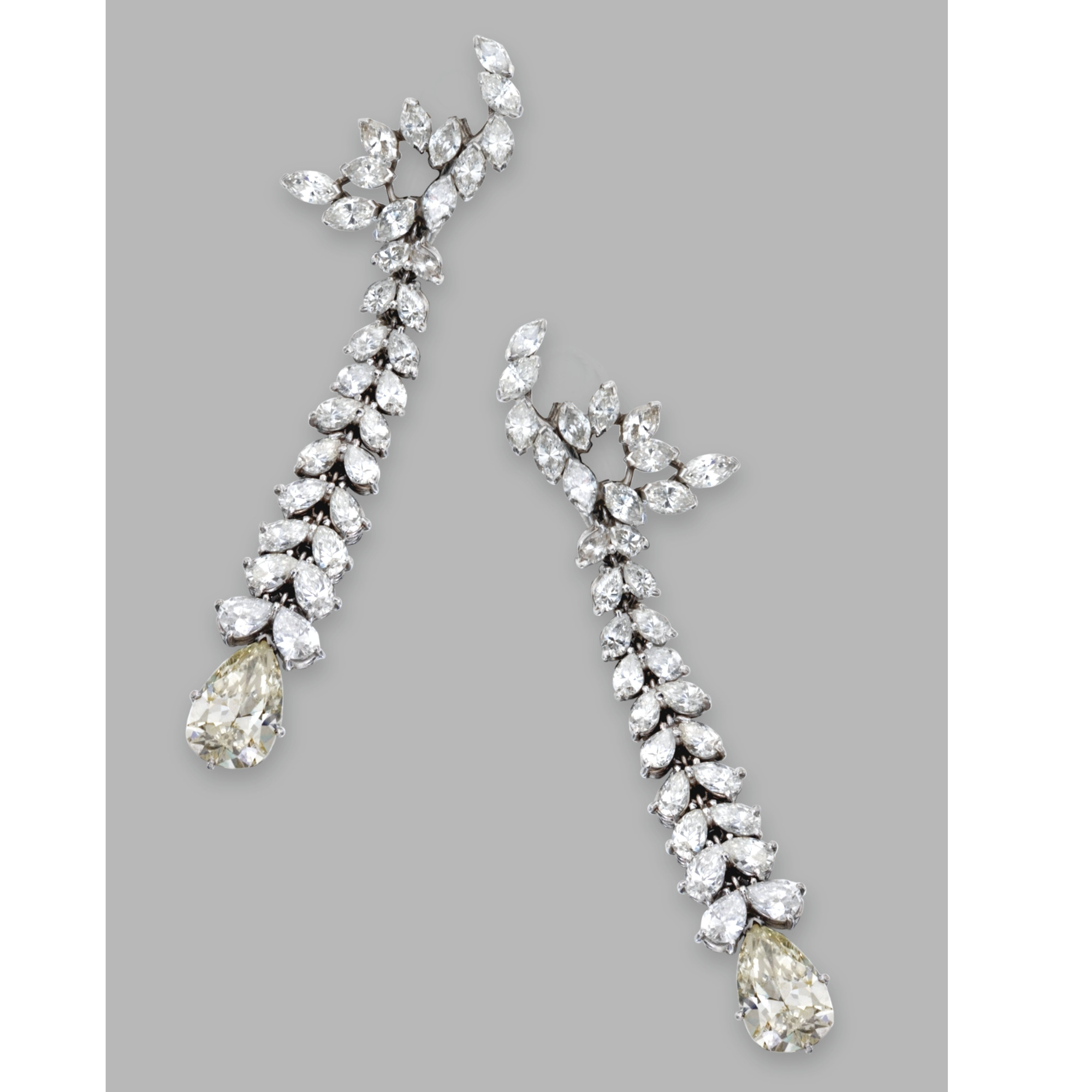 Pair of platinum and diamond pendantearclips the highly articulated