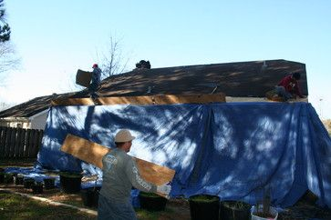 Protecting the home while removing the old shingles.