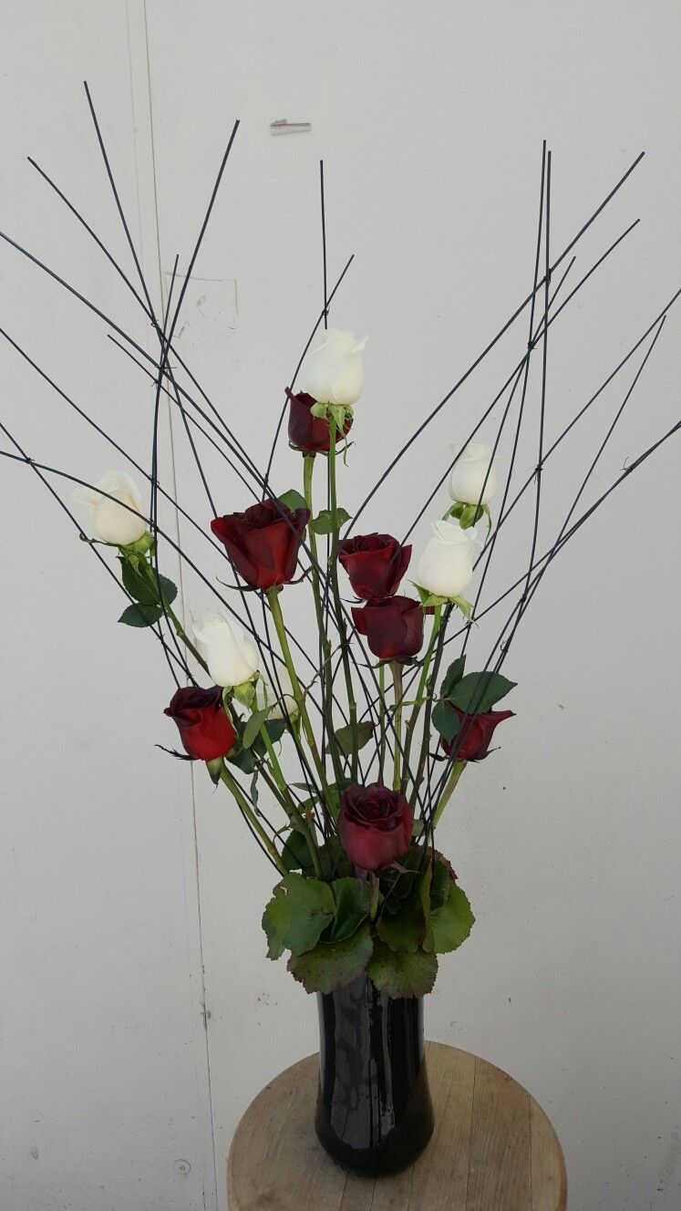 Red and white and black flower arrangements for wedding and events