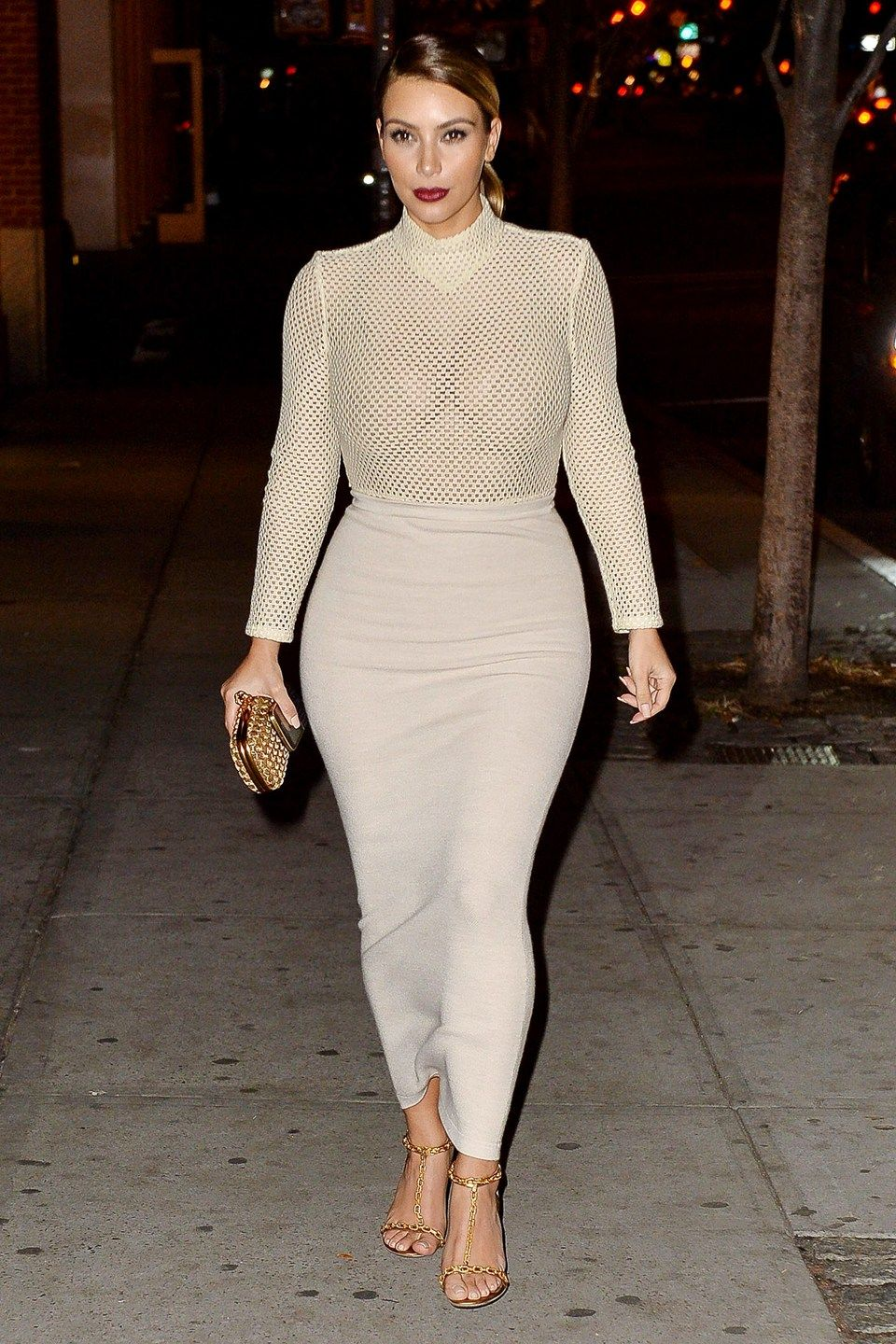 38773b2e39 Kim Kardashian teamed a perforated Veronique Leroy polo neck with a  figure-hugging Donna Karen maxi skirt, Tom Ford chain-detail heels, a low  pony and a red ...