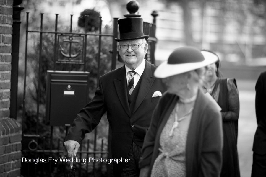 Guests arriving at Church in London - black and white wedding photograph