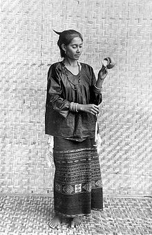 Pusaka Collection of Indonesian Ikat. Kisar woman spindle spinning on early 20th C.