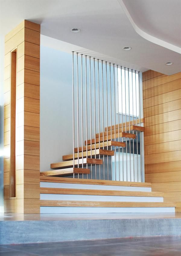 Stainless steel rods provide deceptively solid support for a stair ...