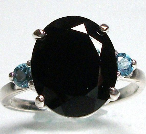 Black spinel accented with blue topaz cocktail by Michaelangelas, $58.50