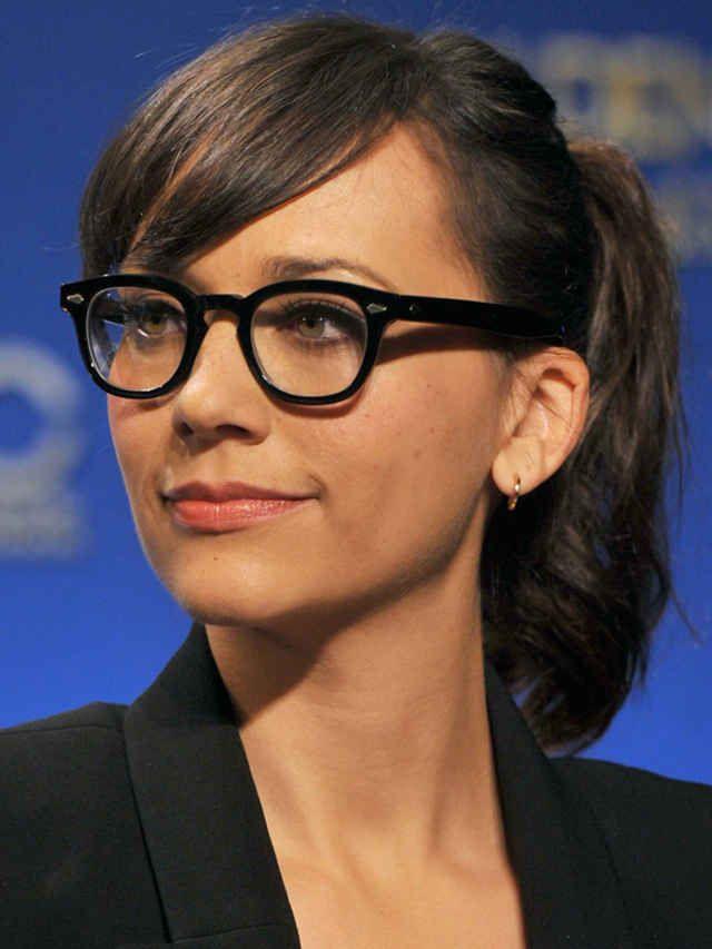 53ff9d7e97 Rashida Jonees with long side-swept bangs and glasses.