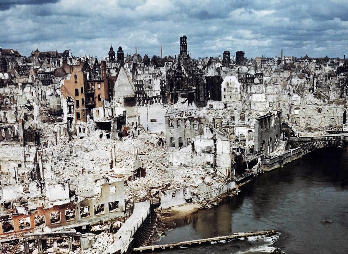 A color photograph of the bombed-out historic city of Nuremberg, Germany in June of 1945, after the end of World War II. Nuremberg had been the host of huge Nazi Party conventions from 1927 to 1938. The last scheduled rally in 1939 was canceled at the last minute due to a scheduling conflict: the German invasion of Poland one day prior to the rally date. The city was also the birthplace of the Nuremberg Laws, a set of draconian antisemitic laws adopted by Nazi Germany. Allied bombings from…