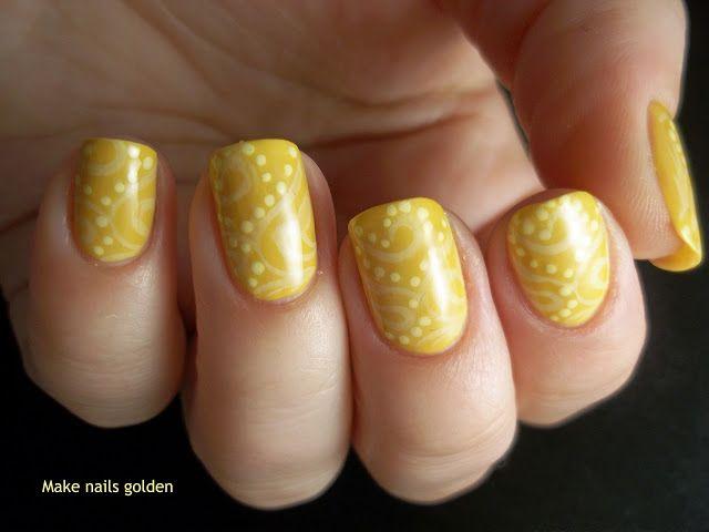 Uñas amarillas con estampado y puntos ;)