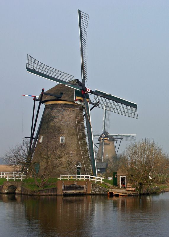 """✈ Windmills of Kinderdijk, Netherlands. While we were there we got to visit the inside of a functioning windmill. I remember thinking """"How could anyone live here with all that noise""""?"""