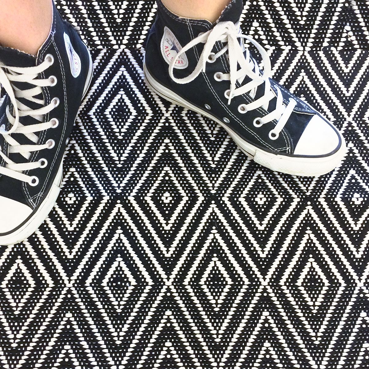 Converse shoes on a Dash and Albert Diamond Black/Ivory Indoor ...