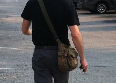 Is it wrong for men to carry purses?
