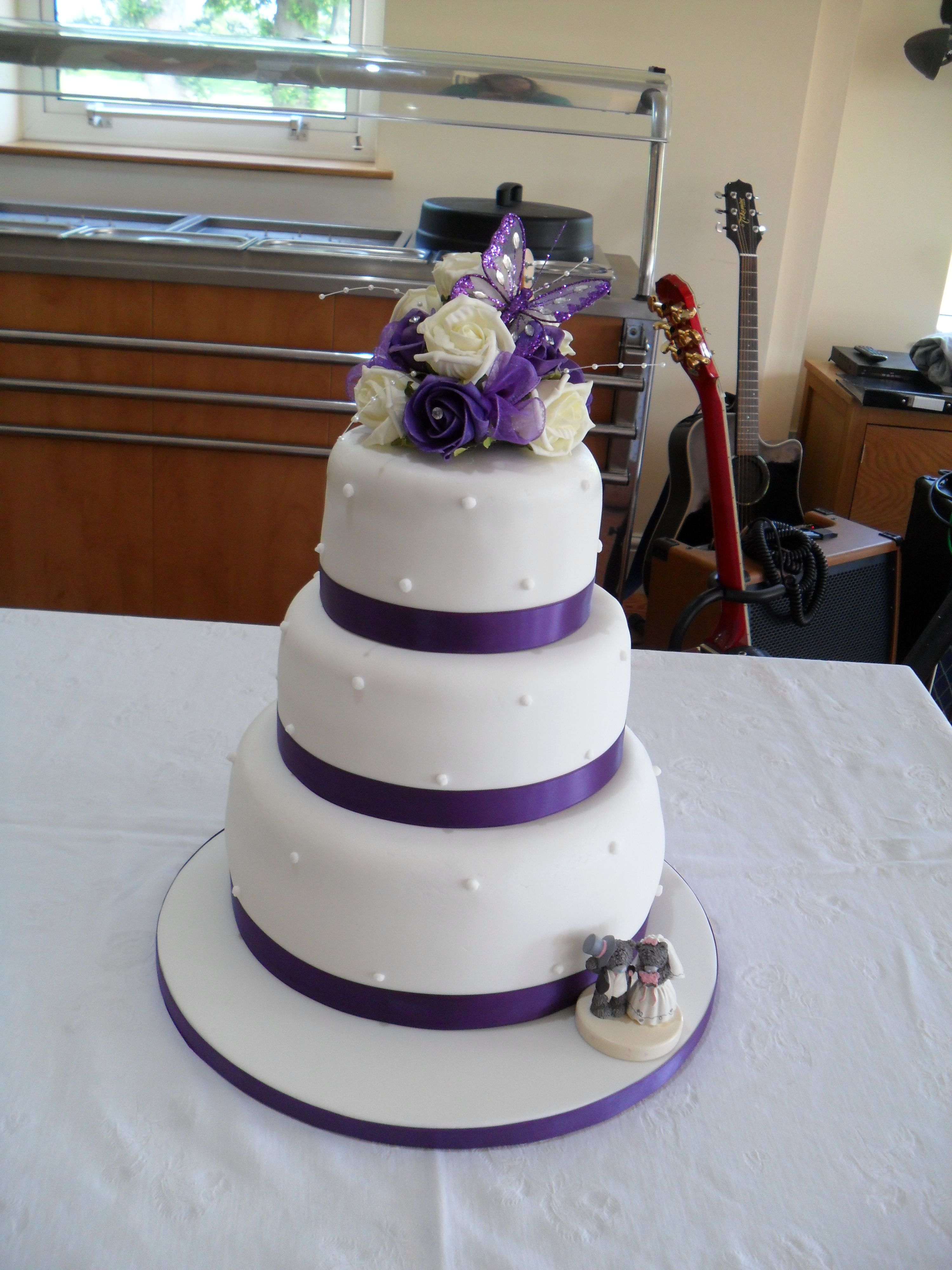 3 Tier Wedding Cake Purple Ribbons And Arrangement 3 Tier