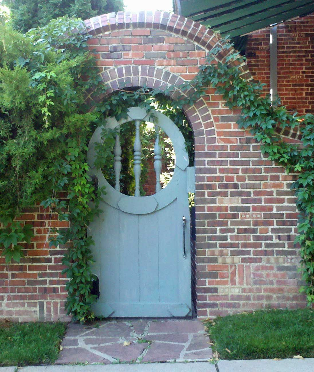 The Art Garden On The Street 10th Avenue Denver Brick Wall Gardens Wooden Garden Gate Brick Garden