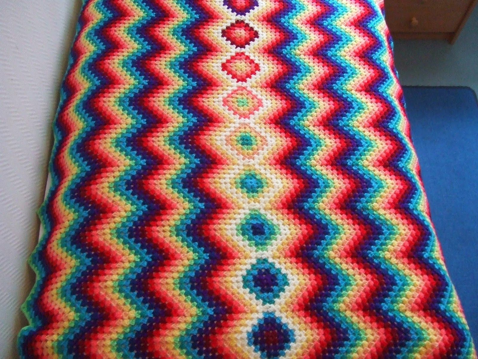 beautiful colorful #crochet blanket with granny squares and chevrons ...