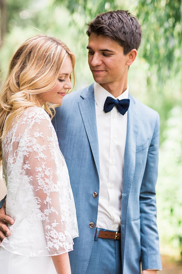 groom in a blue suit and bow tie