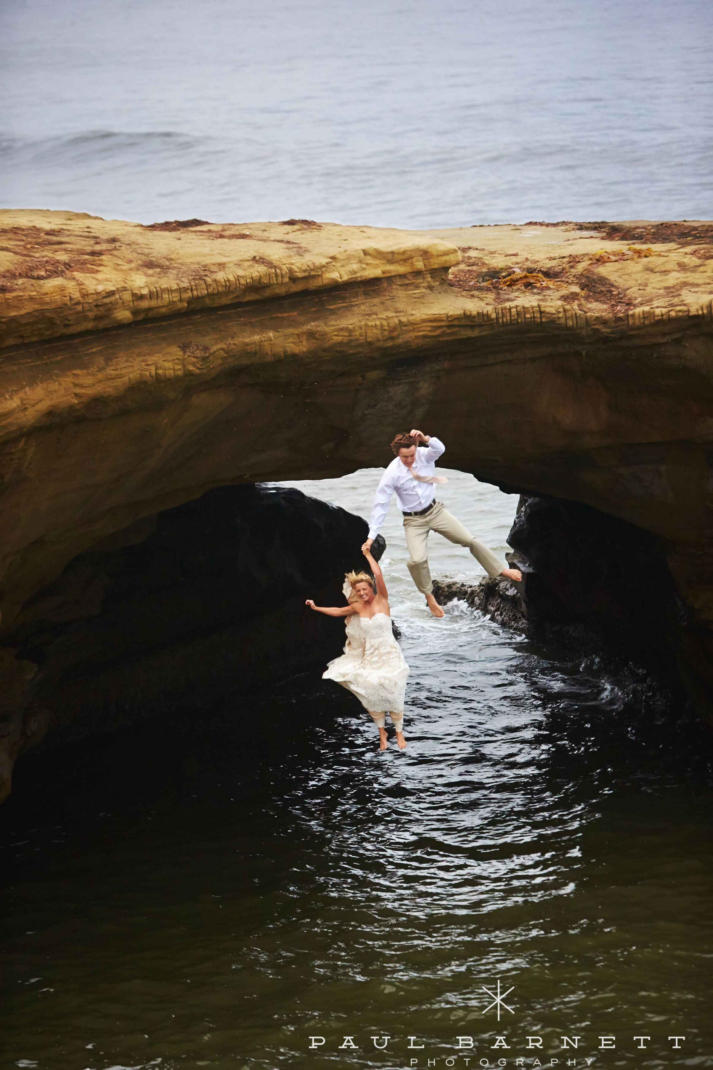 beach wedding places in california%0A Two weeks after this couple u    s wedding  they asked us to photograph them in  their wedding attire jumping off Sunset Cliffs in Ocean Beach  San Diego    CA