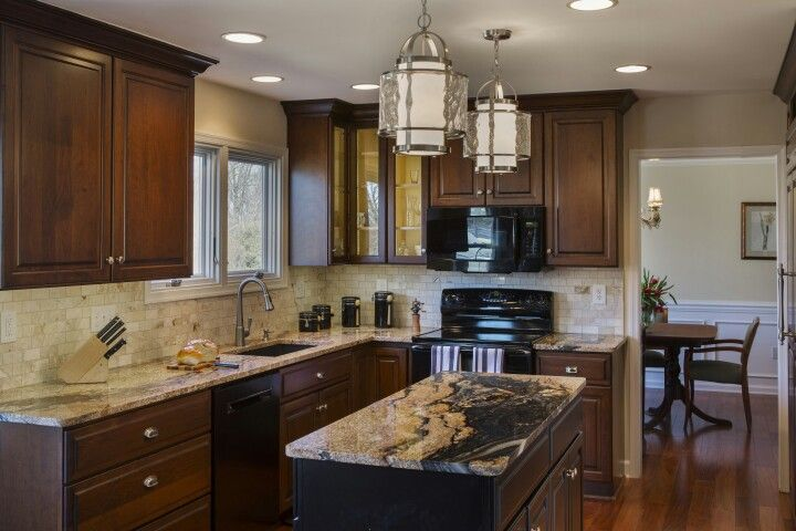 Cherry Wood Kitchen Cabinets With Features Like Detailed Door Profiles And Beautiful Ornamentation Cherry Wood Kitchen Cabinets Kitchen Design Home Kitchens