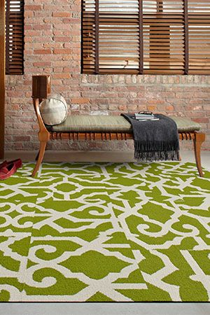 Exposed Brick Walls Bright Green Grahic Rug Chic Chaise Living Room Heaven With Images Contemporary Area Rugs