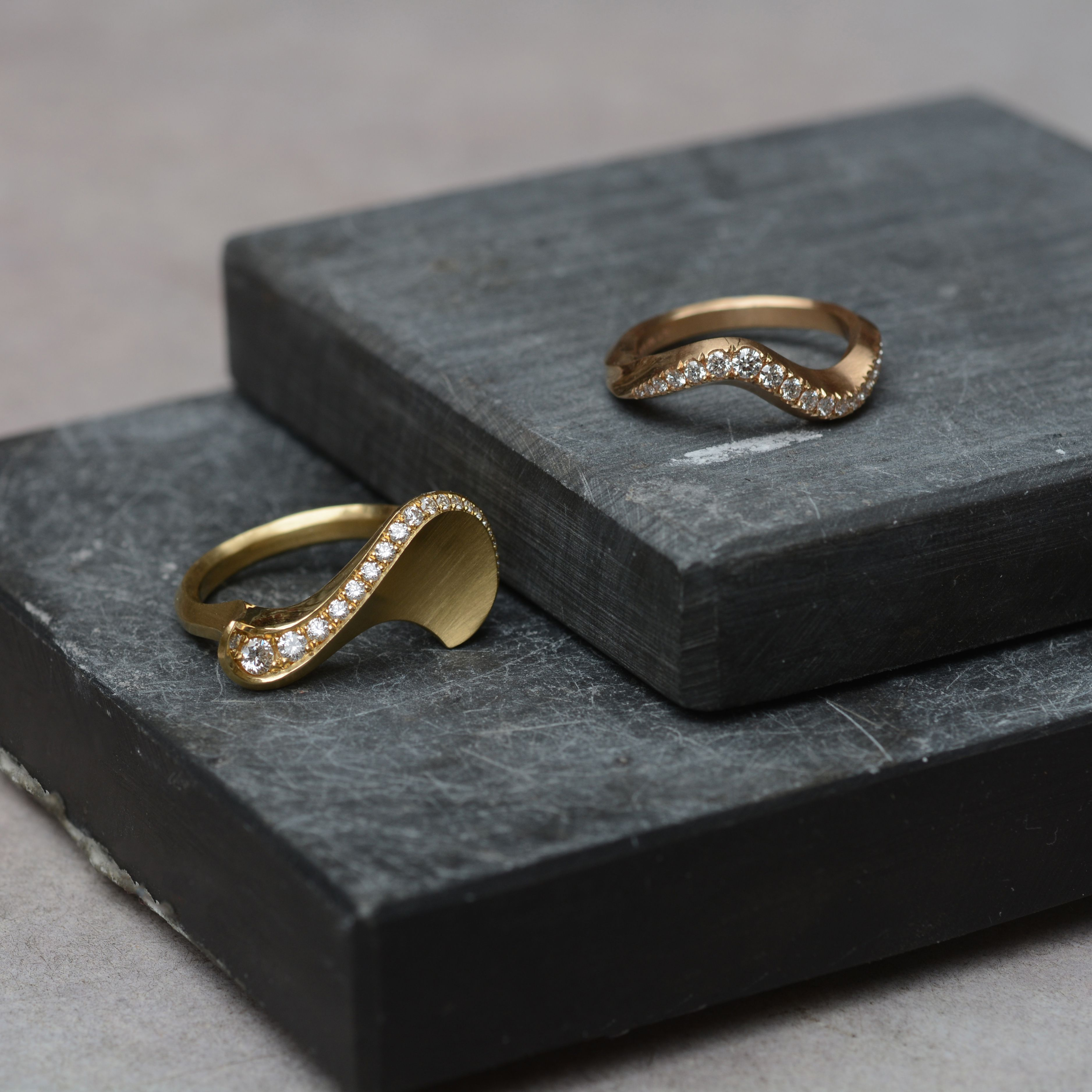 Two of our unique hand carved rings, each sculpted in wax and cast in 18ct gold. Which one would you choose?  #sigmaring #arrisring #handcarved #handcraftedjewellery #handmadelondon #finejewellery #contemporaryjewellery #jewelleryatelier #jewellerygram #uniquejewellery #bespokejewellery #dressring #engagementring #weddingring #goldsmithing