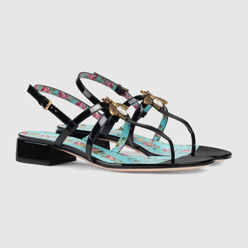 442fe09779bb5d Shop the Patent leather sandal with bee by Gucci. Fashioned from gold-toned  metal