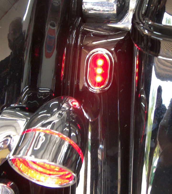 Set Of Red Plugz Antenna Hole Filler Lights On Street