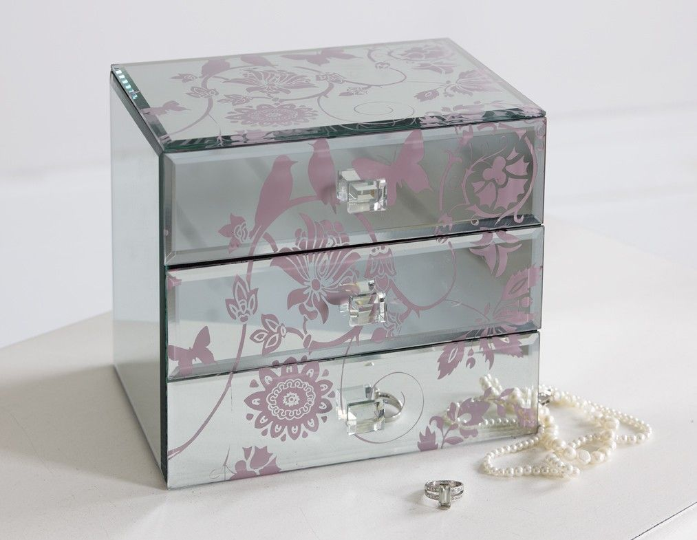 Delicately drawn flowers and birds on a mirrored jewellery box with three very generous drawers. Price £79.00