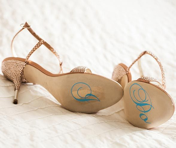 "For her ""Something Blue"", Helena had ""I Do"" written on the bottom of her bedazzled sandals."
