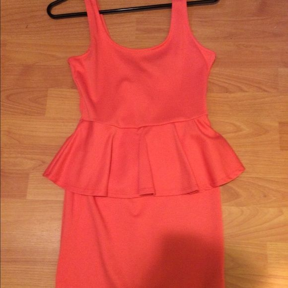 New! Peplum dress New! Forever 21 peplum dress that's a corral color. It no longer has the tags. Forever 21 Dresses Mini