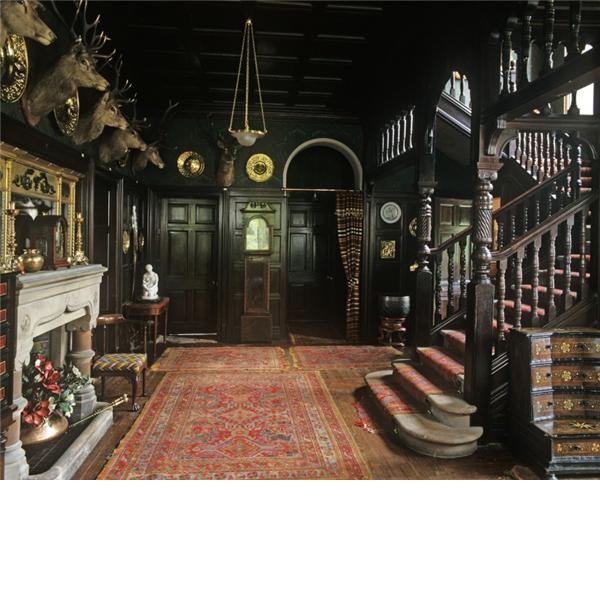 Dark panelled wood, worn Persian carpets...how very fabulous!