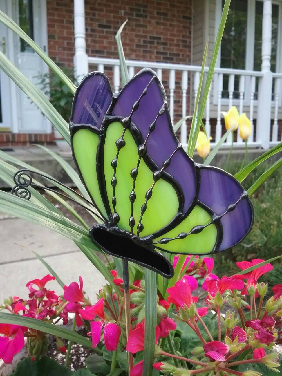 purple and lime green stained glass butterfly garden stake, plant