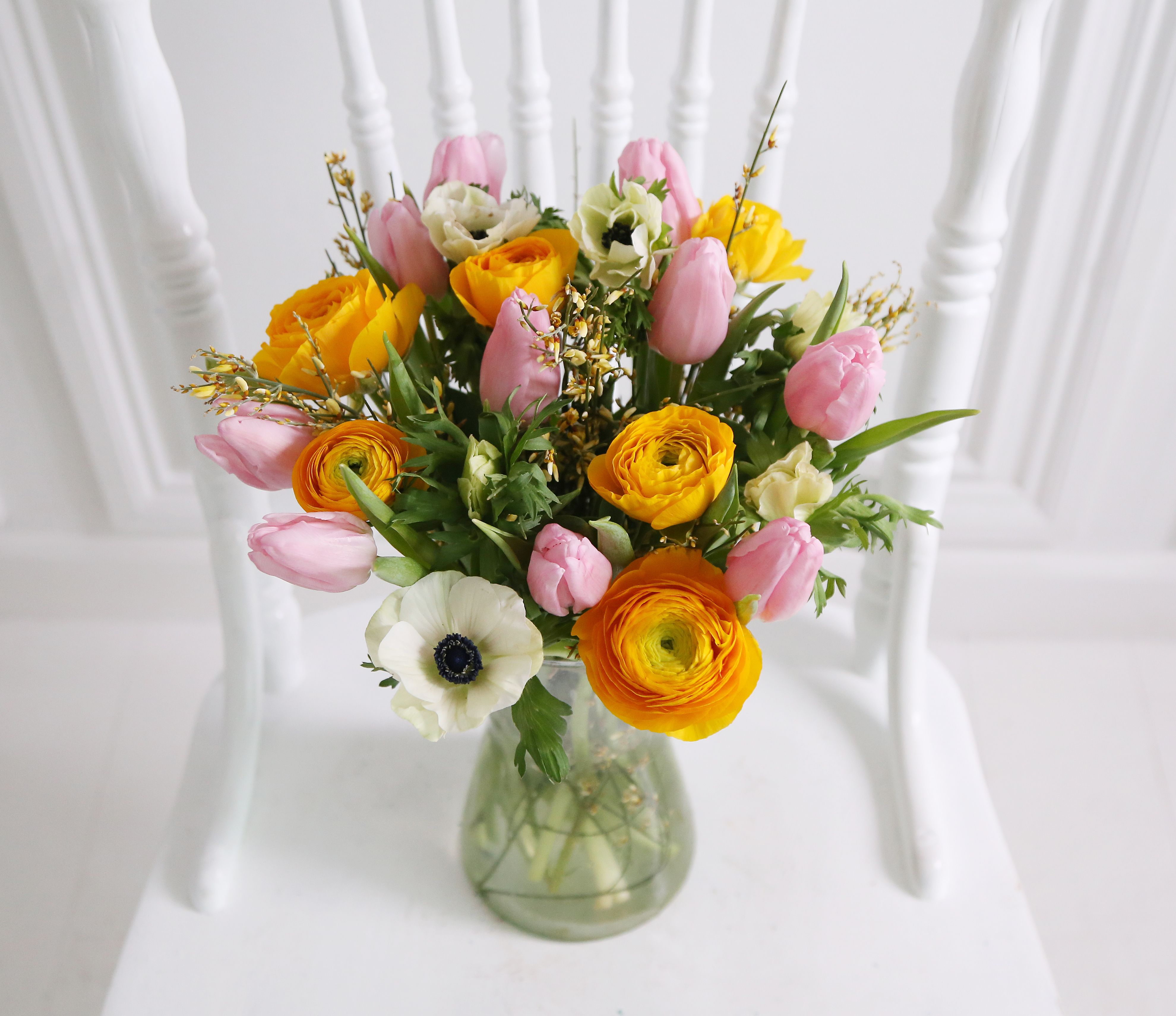 Spring cheer bouquet 6 yellow ranunculus 10 light pink tulip call now on 0800 0350 flower delivery london uk from leading online flower shop arena flowers izmirmasajfo Gallery