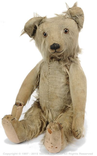 Australian Teddy Bear probably Fideston Toy Factory 1920s, dual brown blonde tipped very long pile mohair plush, clear glass eyes and remains of brown paint to backs, black vertically stitched nose, very broad head with large flat ears, cone shaped muzzle, fully jointed, wool felt pads, black claw stitching, front end - seam, humped back, excelsior stuffing, long tapered arms,