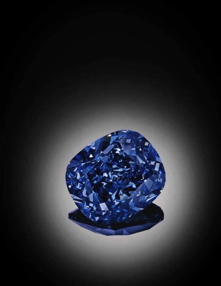 'THE BLUE MOON'. Now 'THE BLUE MOON OF JOSEPHINE'. An exceptional Fancy Vivid Blue diamond ring. The cushion-shaped fancy vivid blue diamond weighing 12.03 carats, mounted as a ring, size 471/2. Estimate 34,083,378 - 53,516,883 USD // LOT SOLD 48,468,158 USD. GIA / Fancy Vivid Blue, Natural Colour, Internally Flawless. Type IIb diamond. Unearthed from the Cullinan mine in January 2014 as a 29.62 carat rough crystal [S. MAGNIFICENT JEWELS AND NOBLE JEWELS - 11 NOVEMBER 2015 - GENEVA] #Vivid