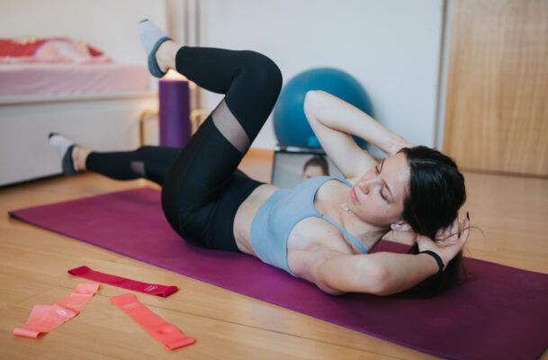 Think full-body Pilates is hard? Just try adding a resistance band