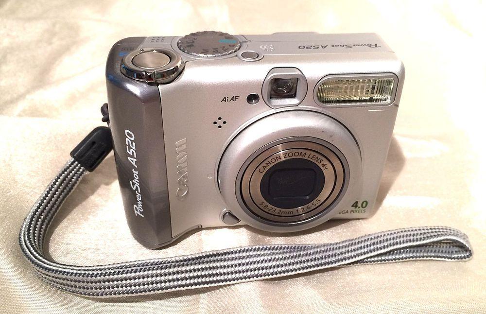 Canon powershot a520 4. 0 mp digital camera silver w/ manuals.