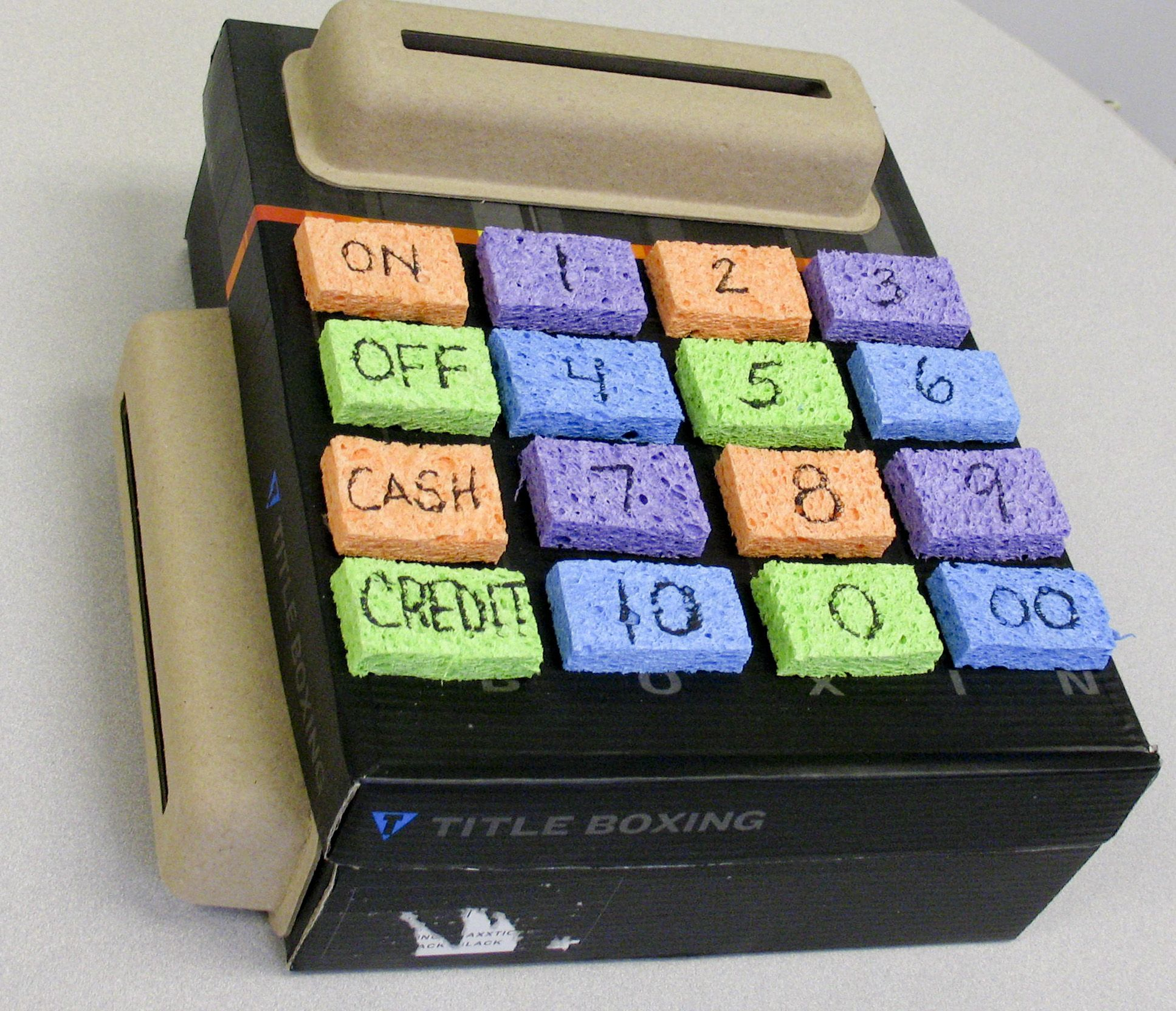 Child care solutions made this cash register out of a