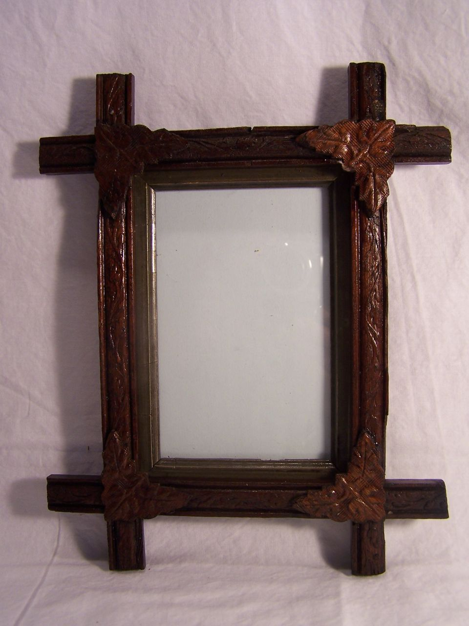 this adirondack eastlake rustic tramp art picture frame has beautifully carved leaves on the corners