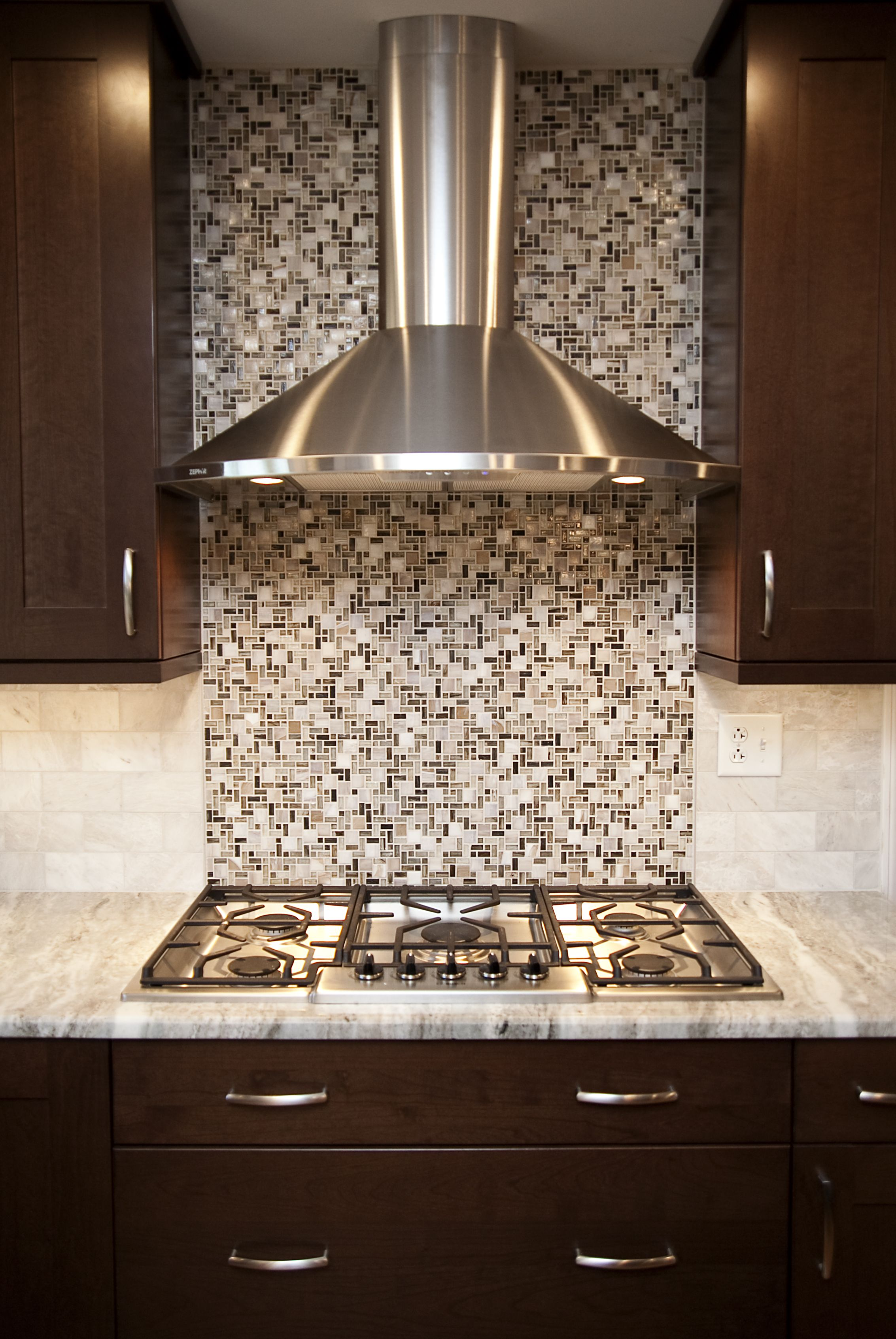 Transitional naperville kitchen remodel beautiful stainless hood beautiful stainless hood highlights the cooktop area along with glass mosaic backsplash tile dailygadgetfo Images