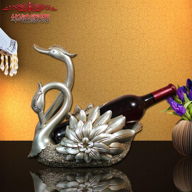 https://www.aliexpress.com/store/product/The-wedding-gift-of-European-wine-wine-frame-Swan-decorative-resin-crafts/219022_32735186895.html