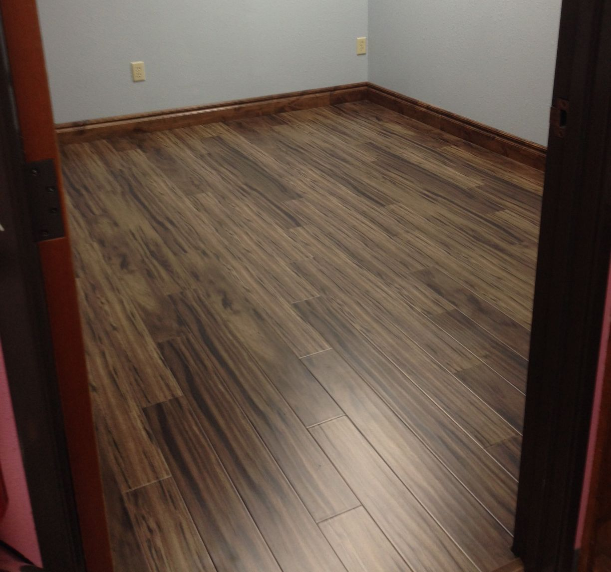 We Used The Fumed African Ironwood Laminate And Quarter Round It Looks Great I Absolutely Love This Flooring Fumed Af Flooring Trends Flooring Ironwood