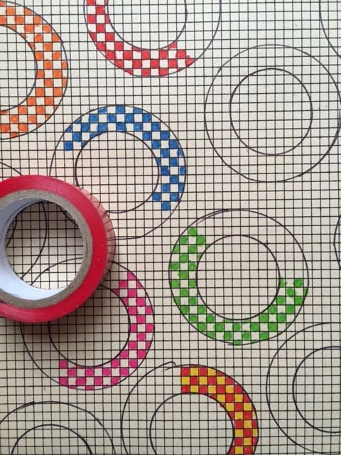 Outline and color in circle doodles on an old stamp album page - graph paper sample