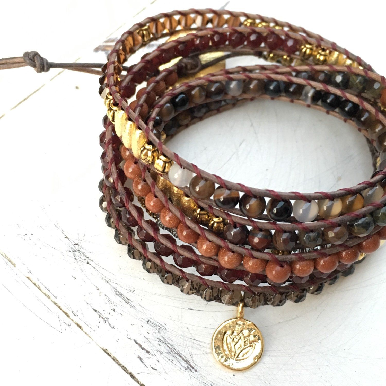 A personal favorite from my Etsy shop https://www.etsy.com/listing/260030754/ruby-lotus-leather-wrap-in-golden