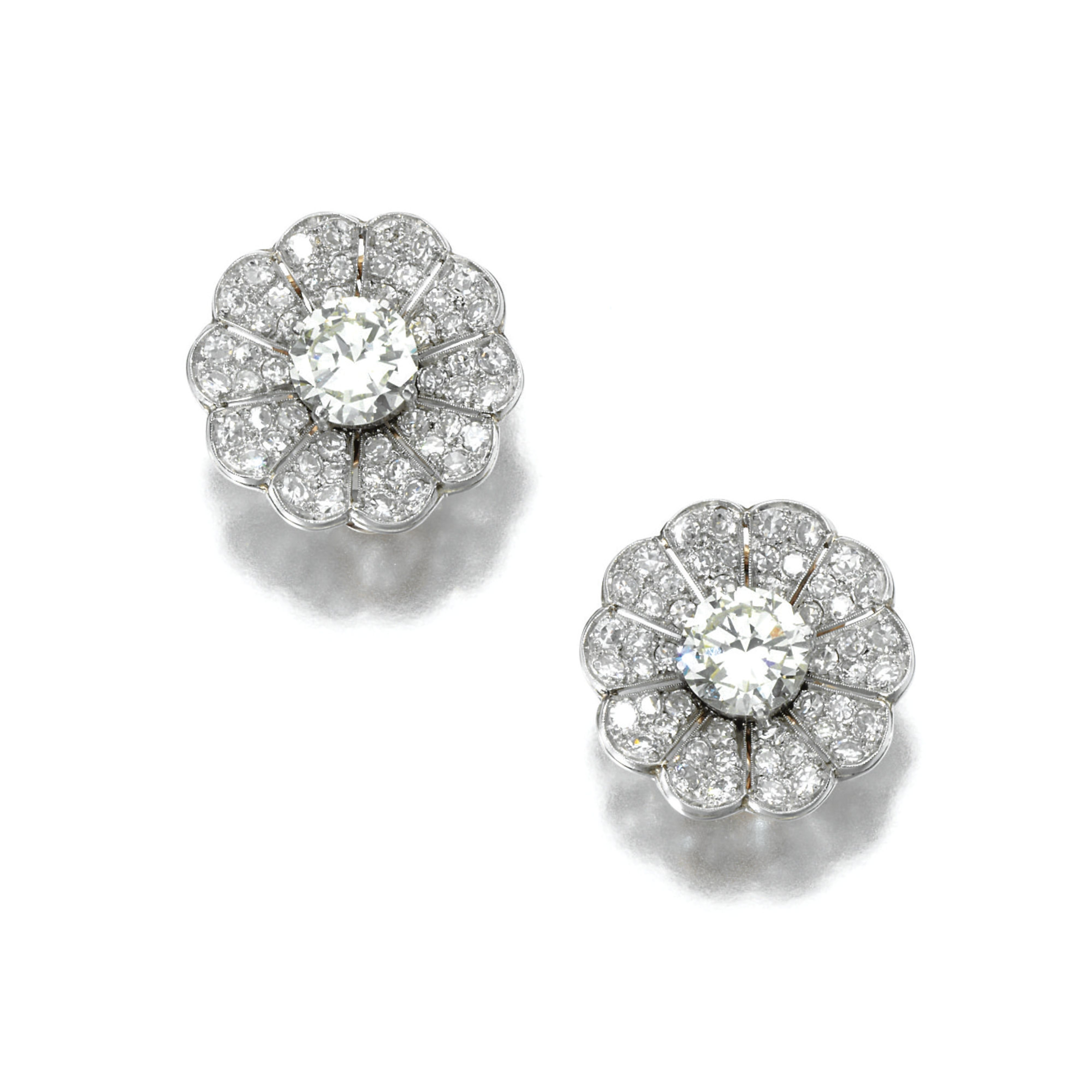 PAIR OF DIAMOND EAR CLIPS  Each designed as a stylised flower, set at the centre with a brilliant-cut diamond, the petals pavé-set with si...