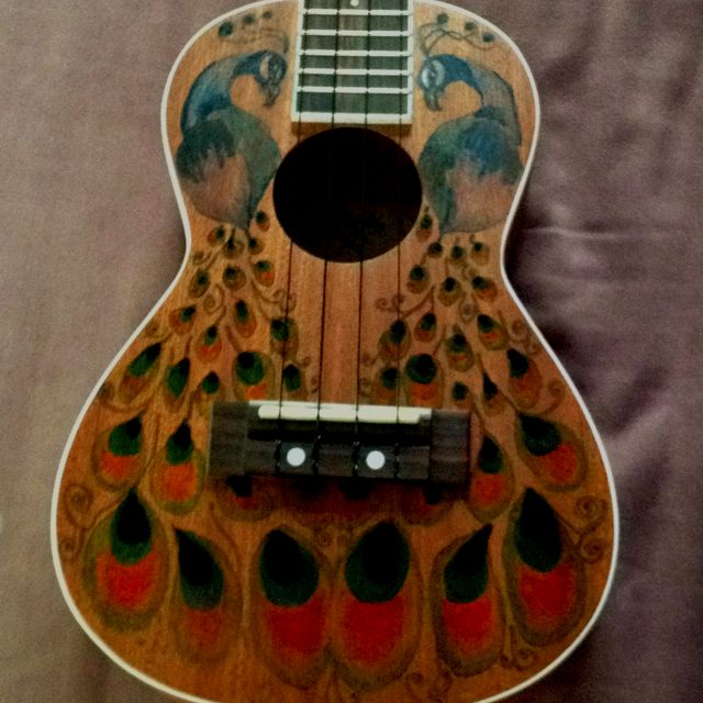 My uke! I used sharpie for the design instead of paint so it would not distort the sound.