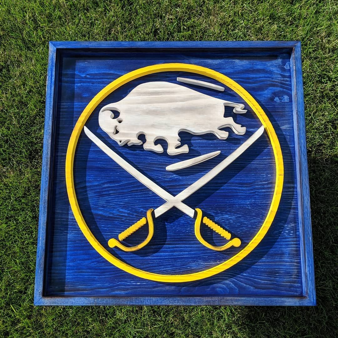 24x24 buffalo sabres logo framed. The gloss finish really makes the color pop! I absolutely love the frame around it.  #wood #woodworking #woodworker #hockey #ks_woodworking #logo #sign #logomaker #signmaker #kylemakessigns #kylemakeslogos #woodworkersofinstagram #scrollsawartist #scrollsaw #dewaltscrollsaw