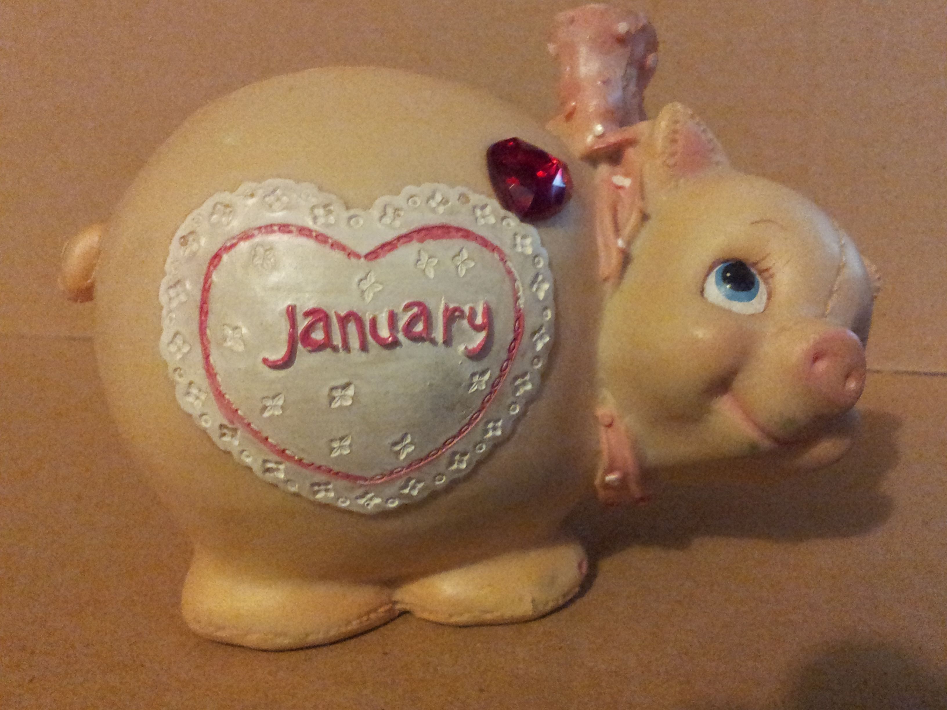Cute old piggy bank. This is listed on Etsy along with other old piggy banks. My shop name is divagirlsartan stuff.