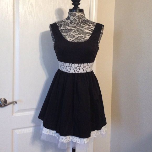 Cute dress black and white New tag still attached. Has low cut back. Lace detail. Zips on the side. Maude Dresses
