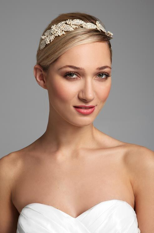 Crystalized leaves and pearl embellishments make this headband from David s  Bridal a gorgeous choice for a Grecian goddess. c2704b500c3